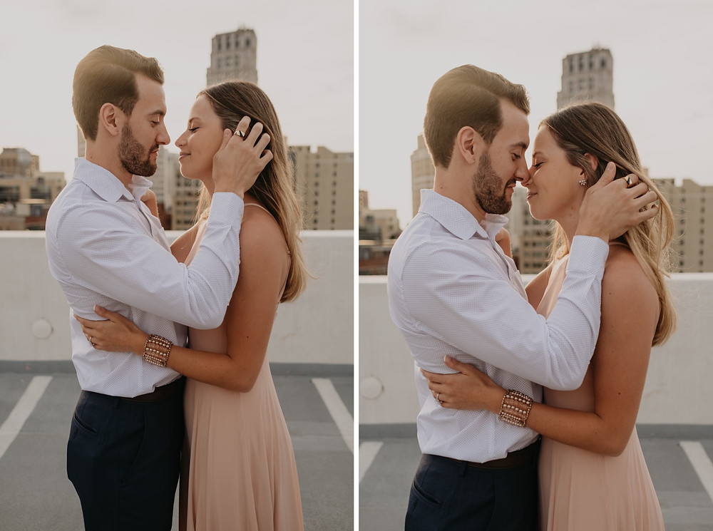 Couple kissing on Detroit rooftop. Photographed by Nicole Leanne Photography.