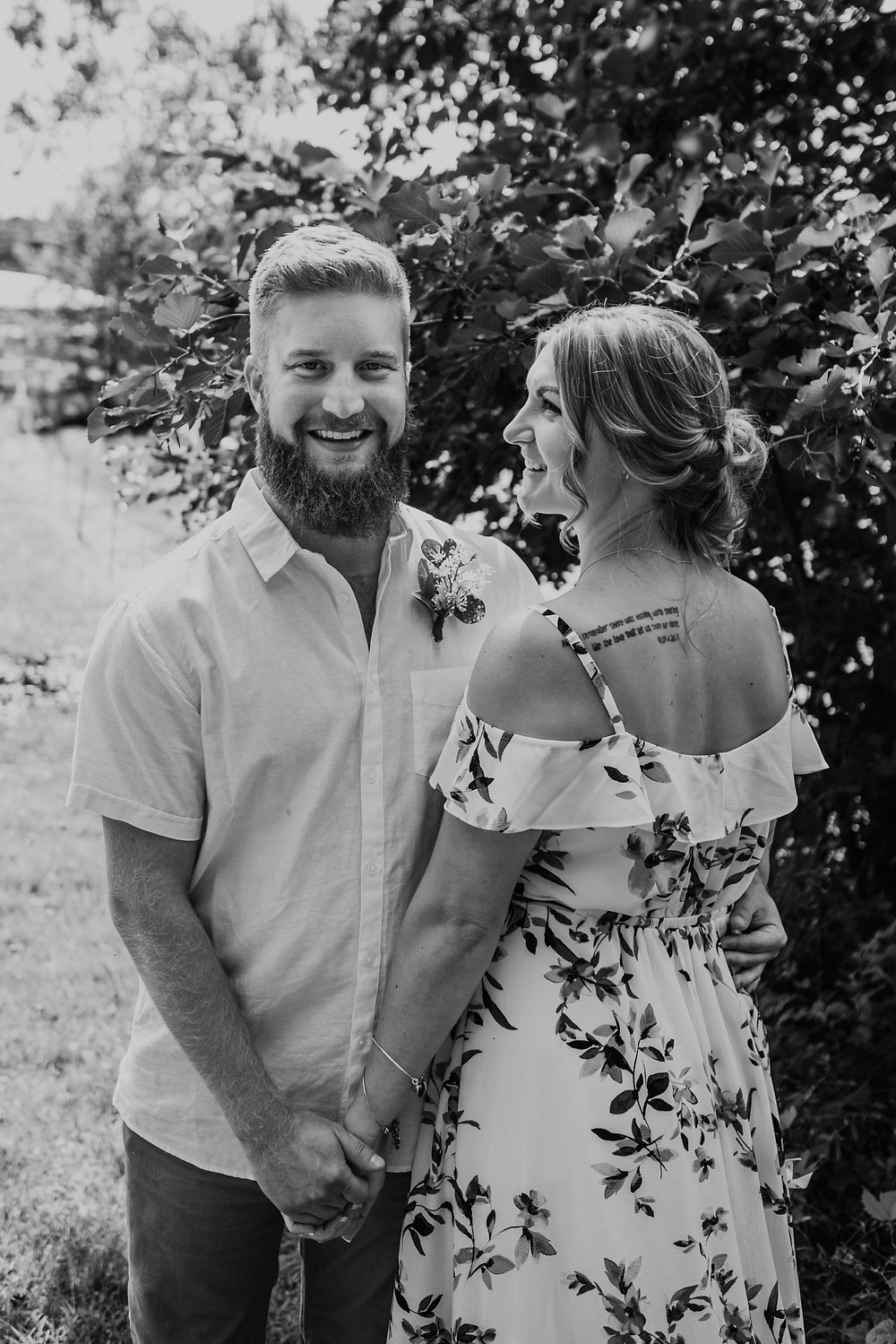 Couple at backyard wedding in Metro Detroit. Photographed by Nicole Leanne Photography.
