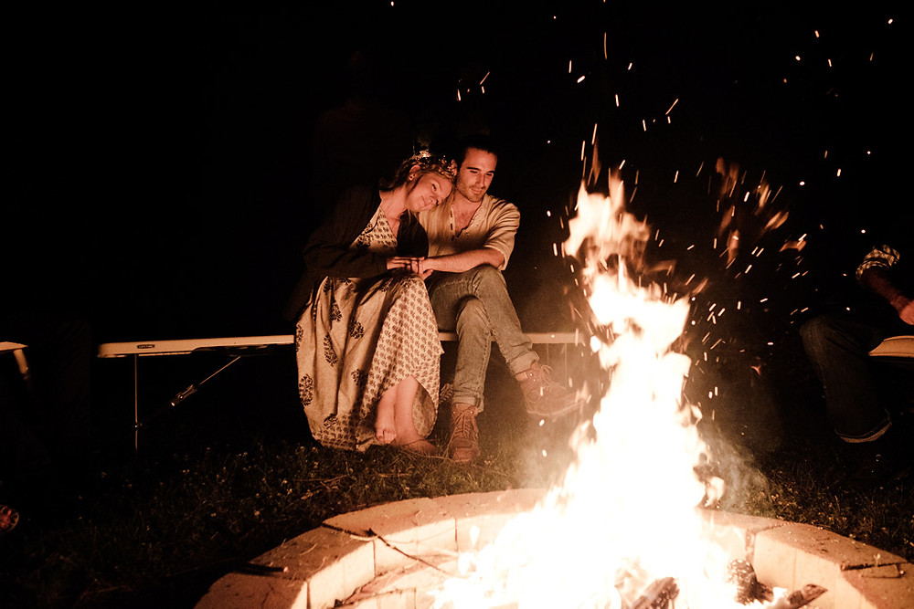 bride and groom by the fire