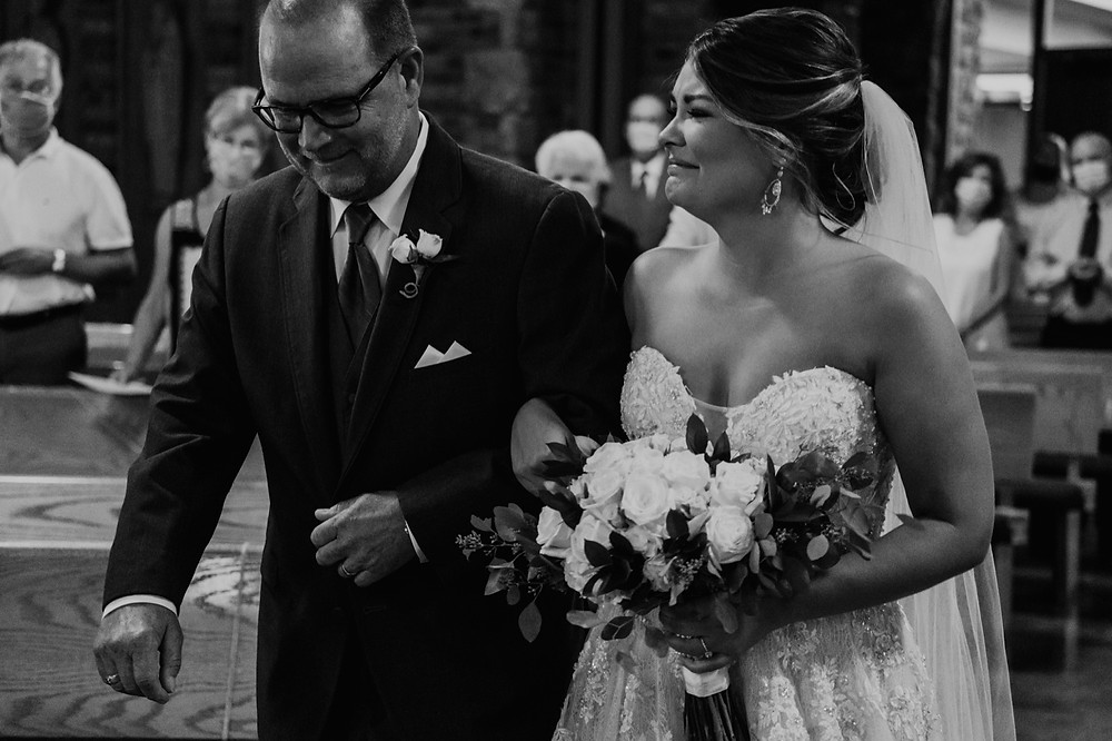 Bride walking down aisle with father. Photographed by Nicole Leanne Photography.