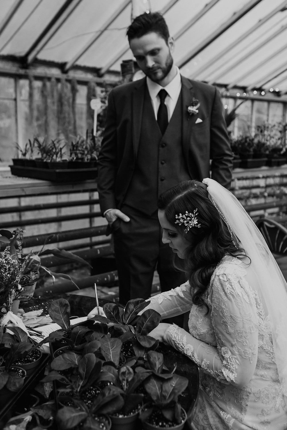 Signing marriage license at Graye's Greenhouse. Photographed by Nicole Leanne Photography.