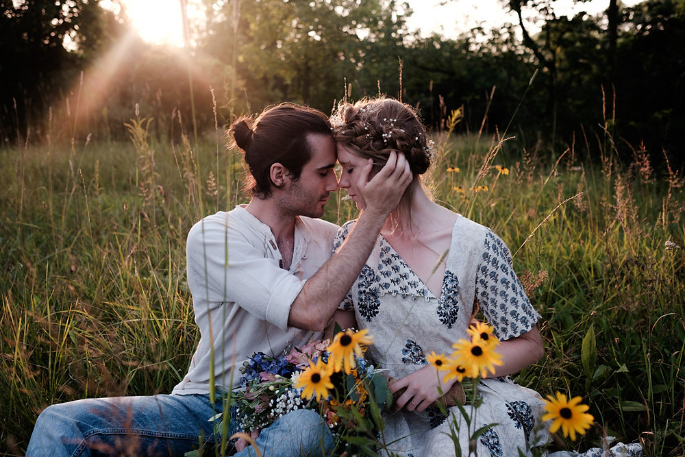 sitting in long grass, wild flowers