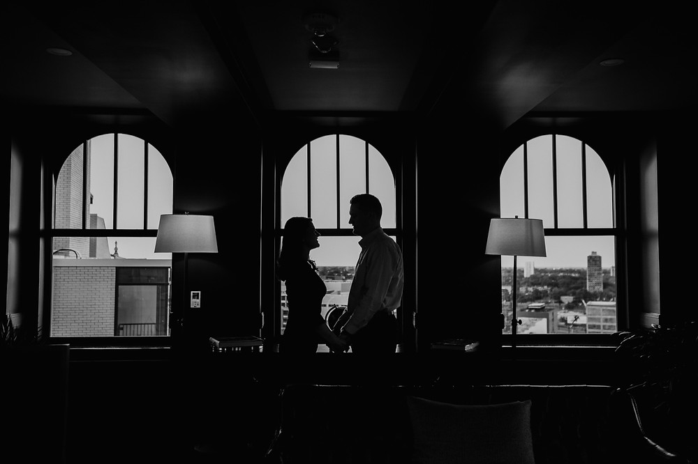 Black and white photo of couple at engagement session at The Monarch Club. Photography by Nicole Leanne Photography