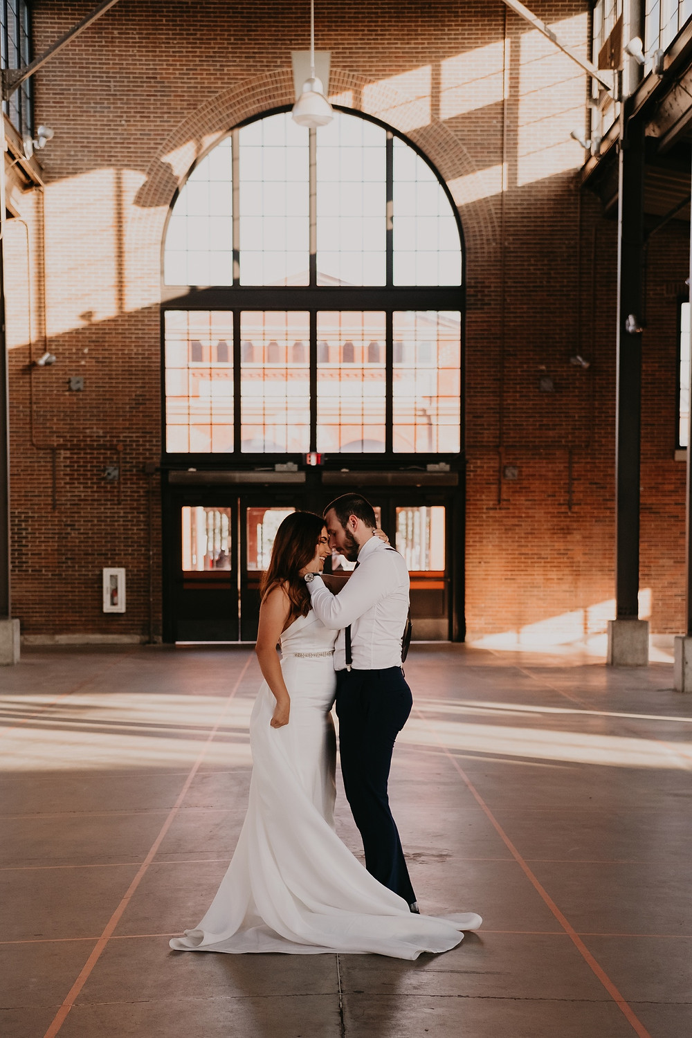 Bride and groom in Eastern Market. Photographed by Nicole Leanne Photography.