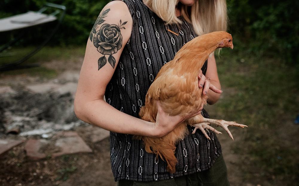 woman holding hen