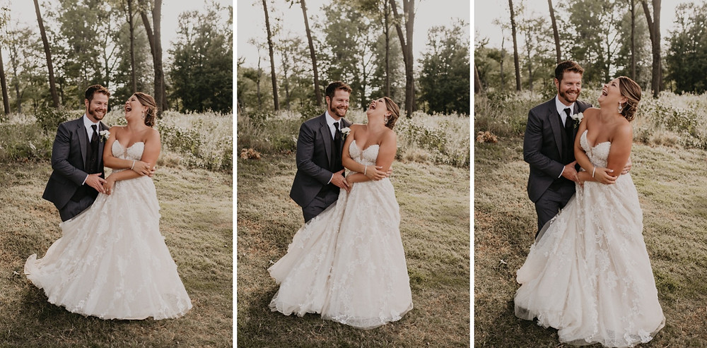 Wedding couple laughing while dancing in field. Photographed by Nicole Leanne Photography.