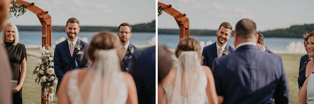 Groom sees bride walking down aisle. Photographed by Nicole Leanne Photography.