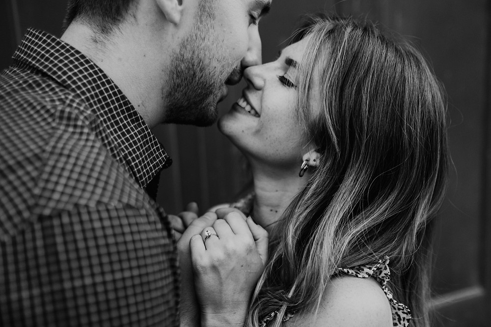 Black and white close up of couple kissing during Detroit engagement. Photographed by Nicole Leanne Photography.