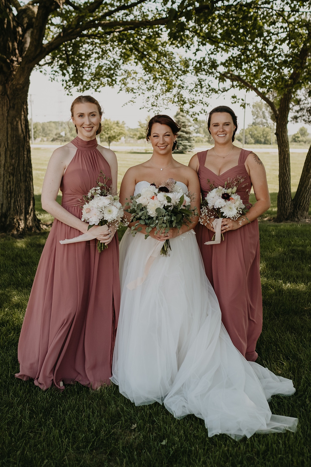 Bride with bridesmaids portraits. Photographed by Nicole Leanne Photography.