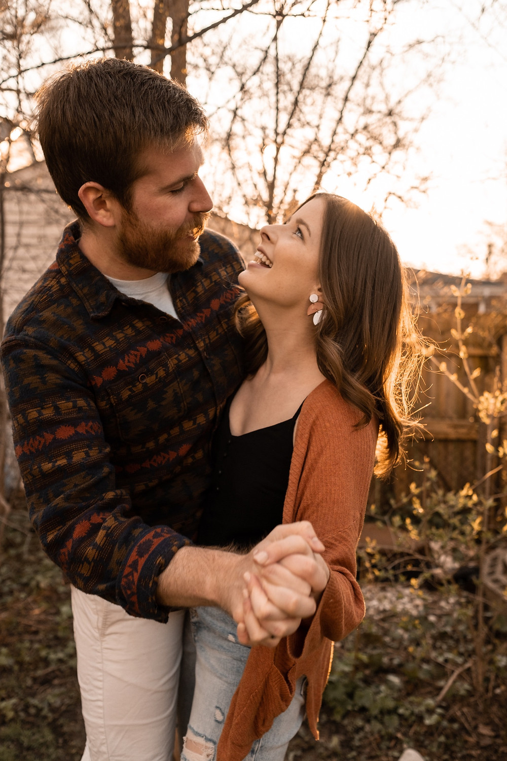 Couple dancing in backyard for photos. Photographed by Nicole Leanne Photography.