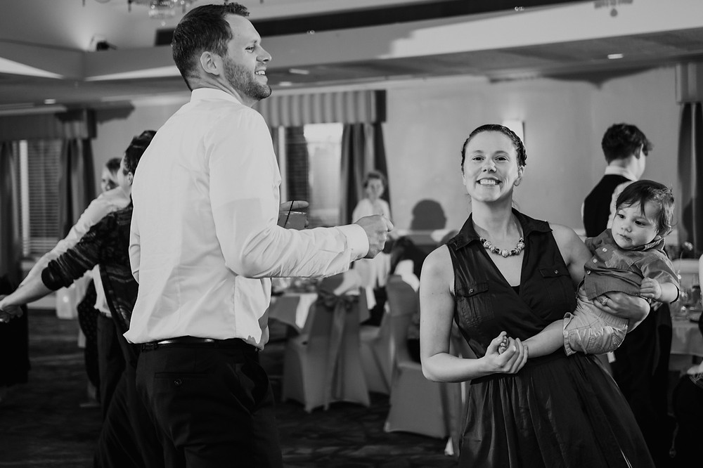 Dancing at wedding candids. Photographed by Nicole Leanne Photography.