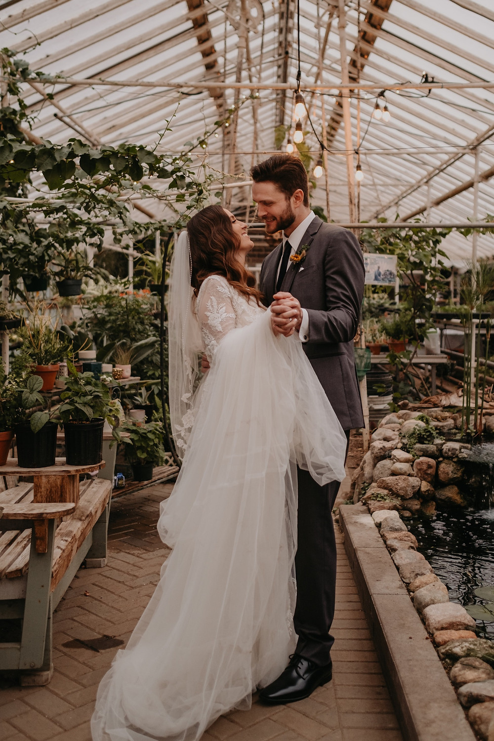 Dancing in greenhouse after wedding ceremony. Photographed by Nicole Leanne Photography.