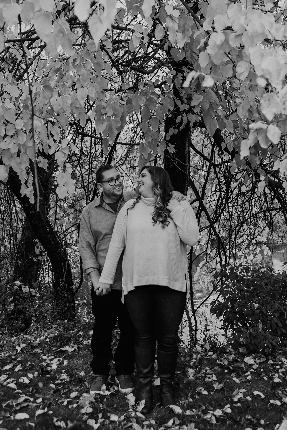 Black and white photos of engaged couple in Metro Detroit. Photographed by Nicole Leanne Photography.