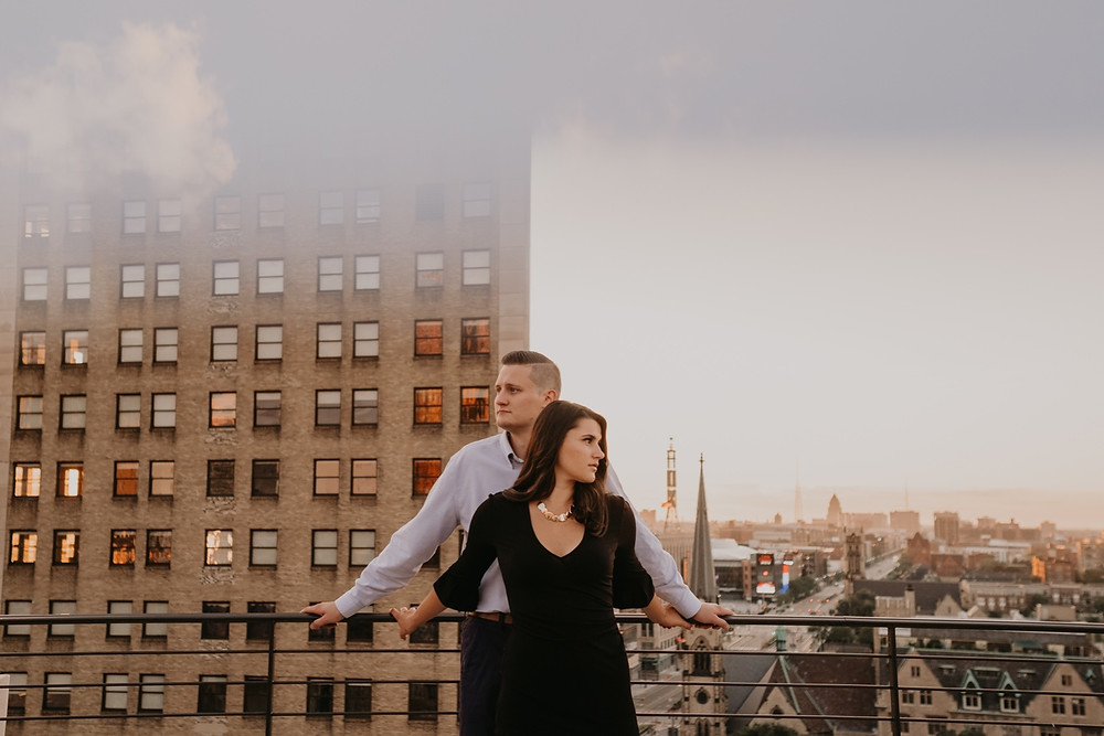 Downtown Detroit rooftop engagement photos. Photographed by Nicole Leanne Photography.