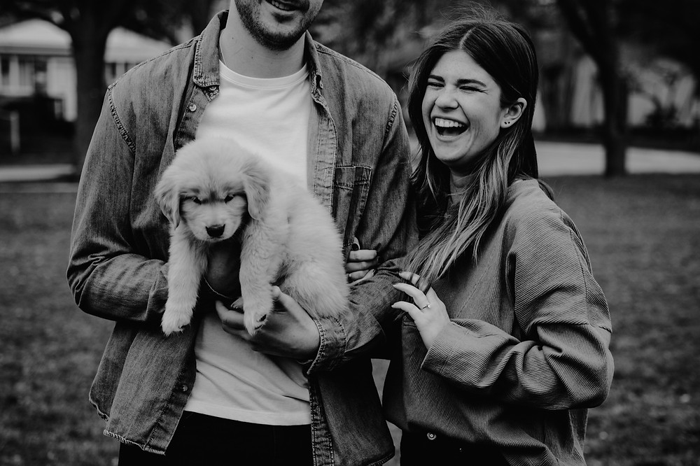 Couple with puppy after wedding proposal in Metro Detroit Michigan. Photographed by Nicole Leanne Photography
