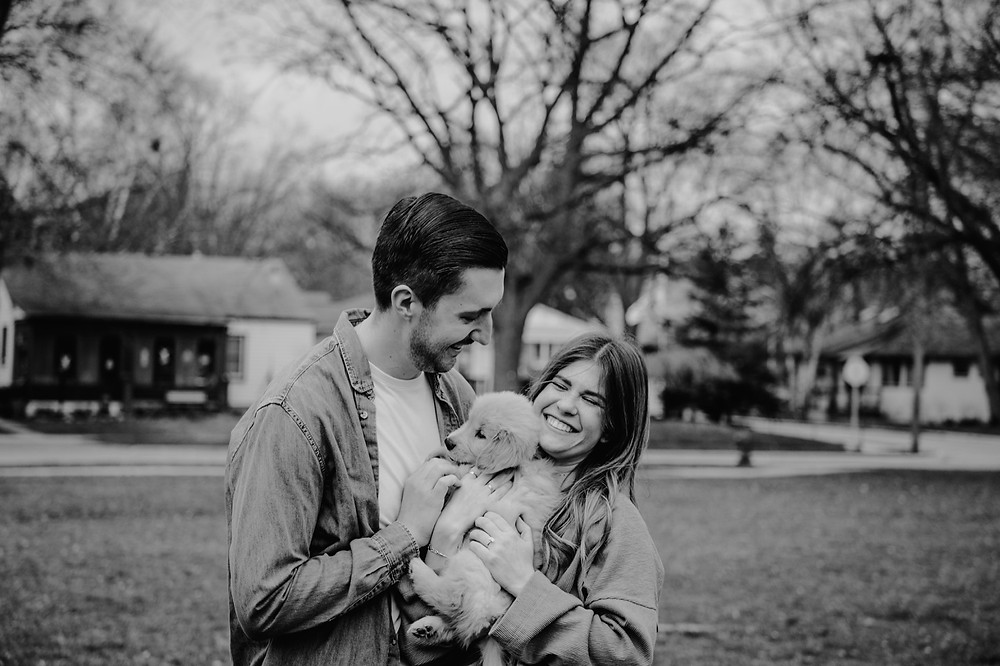 Couple with golden retriever puppy. Photographed by Nicole Leanne Photography.