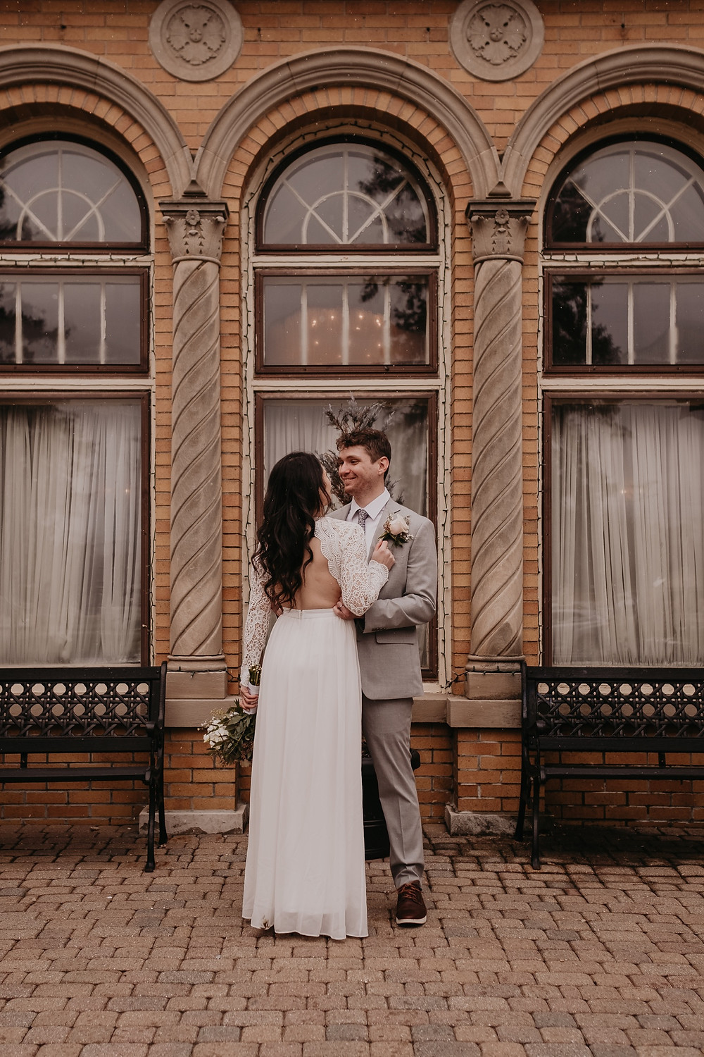 Detroit bride and groom outside Victoria Wedding Chapel in Waterford, Michigan. Photographed by Nicole Leanne Photography