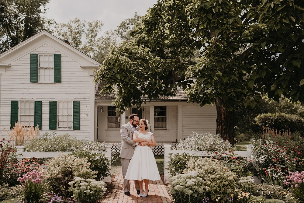 Couple outside home for wedding day portrait.Photographed by Nicole Leanne Photography.