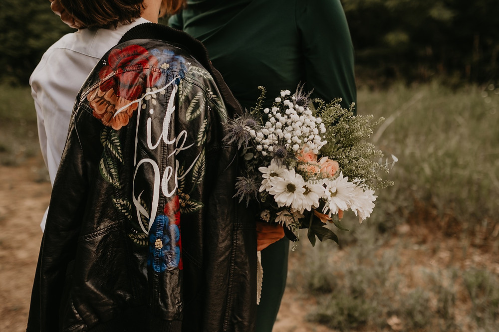 Leather jacket and flowers at commitment ceremony session. Photographed by Nicole Leanne Photography