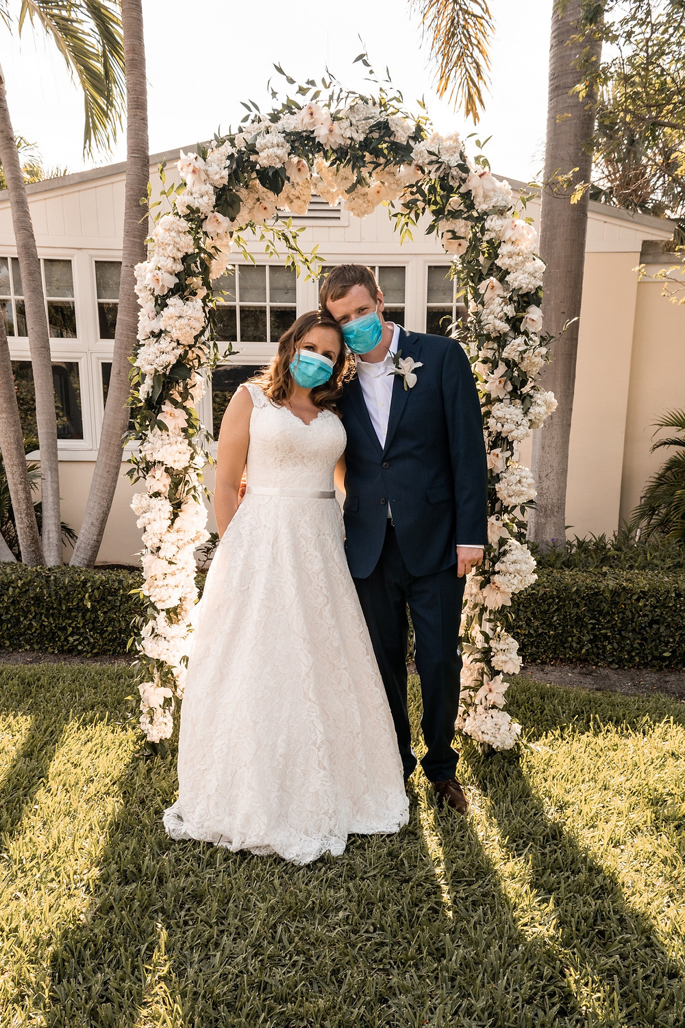Bride and groom in masks at wedding ceremony