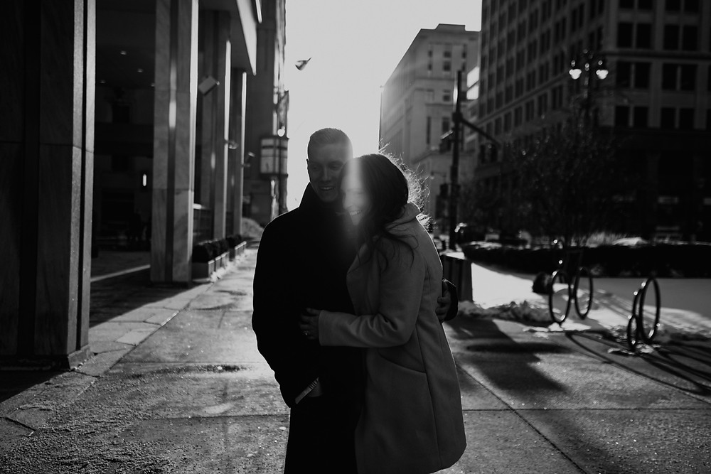 Couple in Downtown Detroit for engagement photos. Photographed by Nicole Leanne Photography.