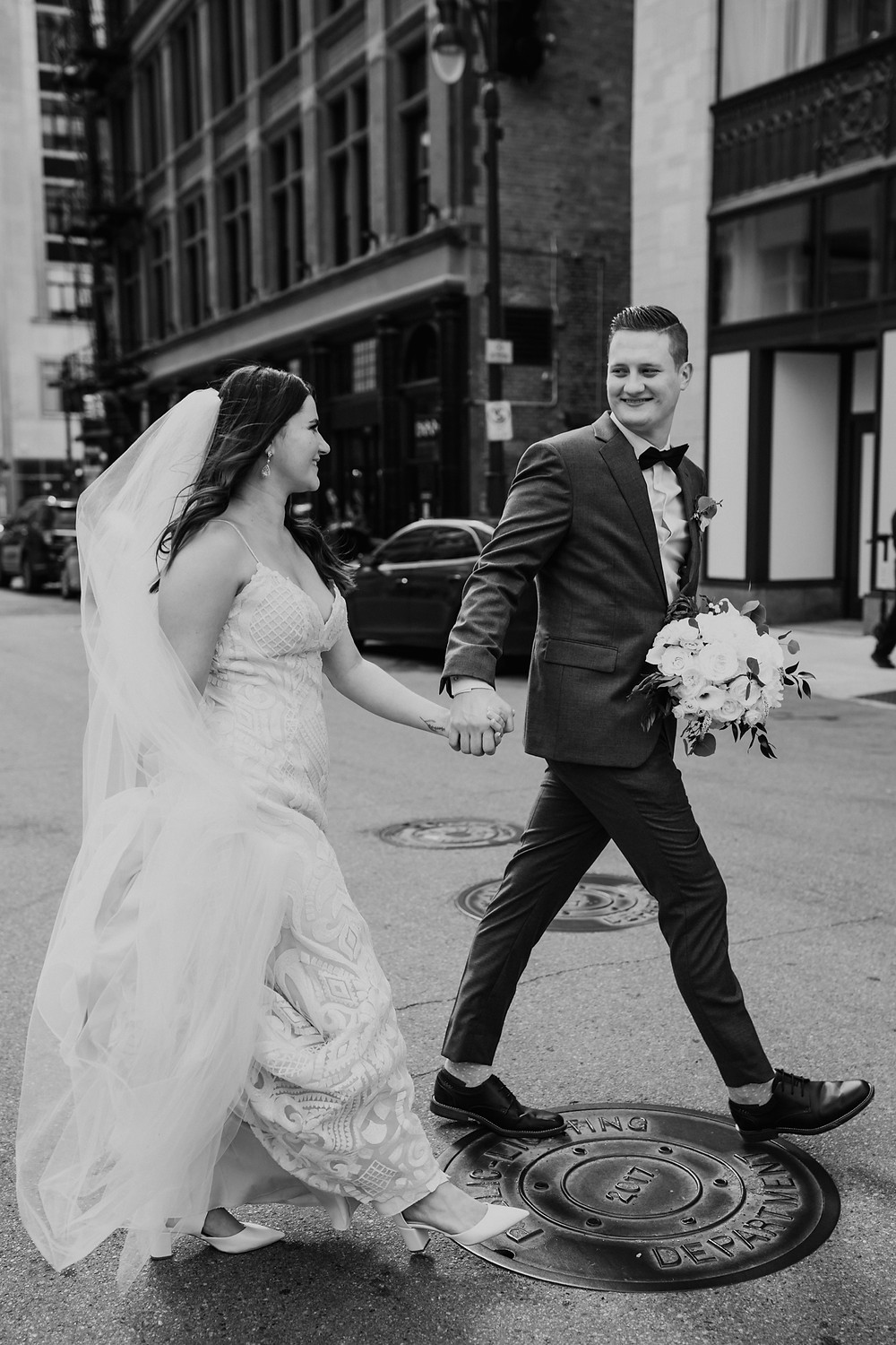 Bride and groom walking around Downtown Detroit.