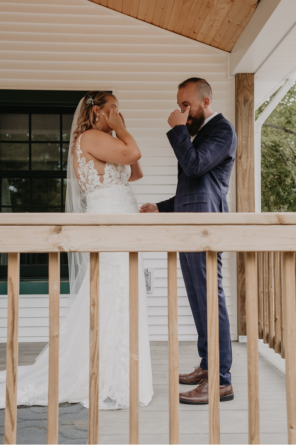 Bride and groom wipe happy tears as they see each other on wedding day. Photographed by Nicole Leanne Photography.