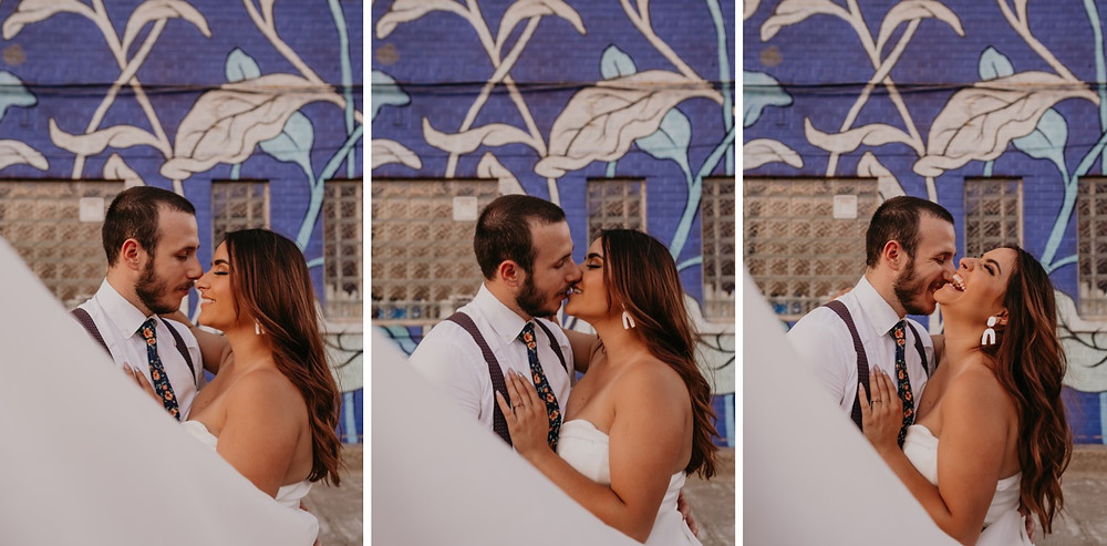 Detroit wedding mural behind bride and groom. Photographed by Nicole Leanne Photography.