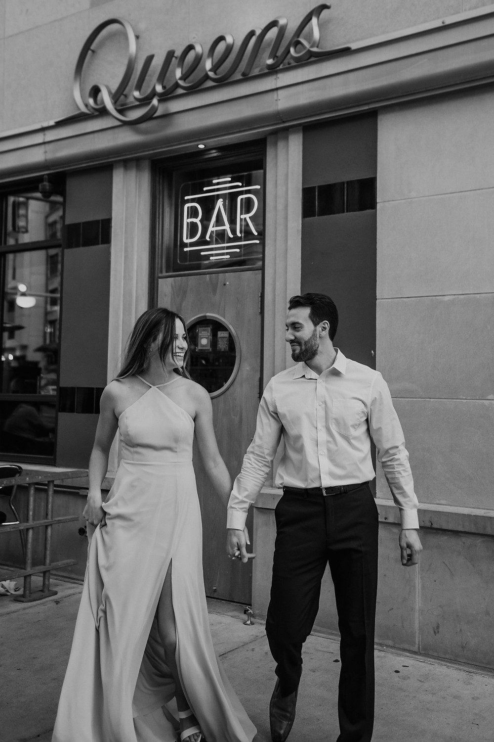 Couple walking outside Queens bar in Detroit Michigan. Photographed by Nicole Leanne Photography.