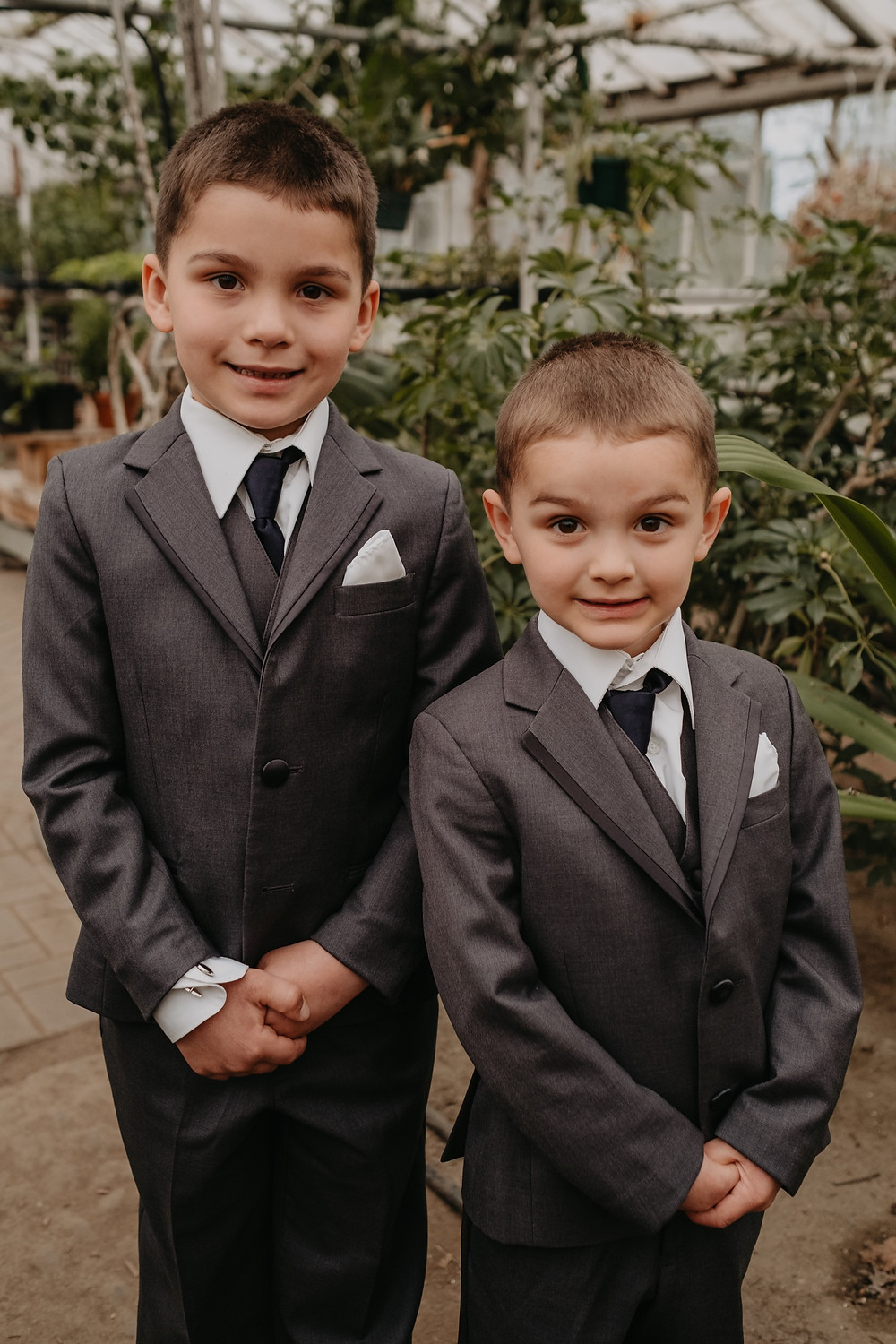 Boys in suits at Graye's Greenhouse wedding.