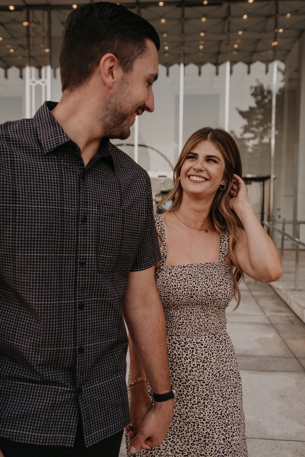 Couple in Downtown Detroit for casual engagement photos. Photographed by Nicole Leanne Photography.