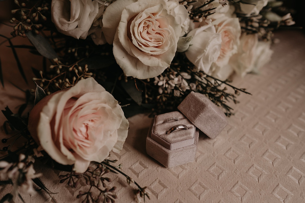 Wedding rings and wedding flowers. Photographed by Nicole Leanne Photography