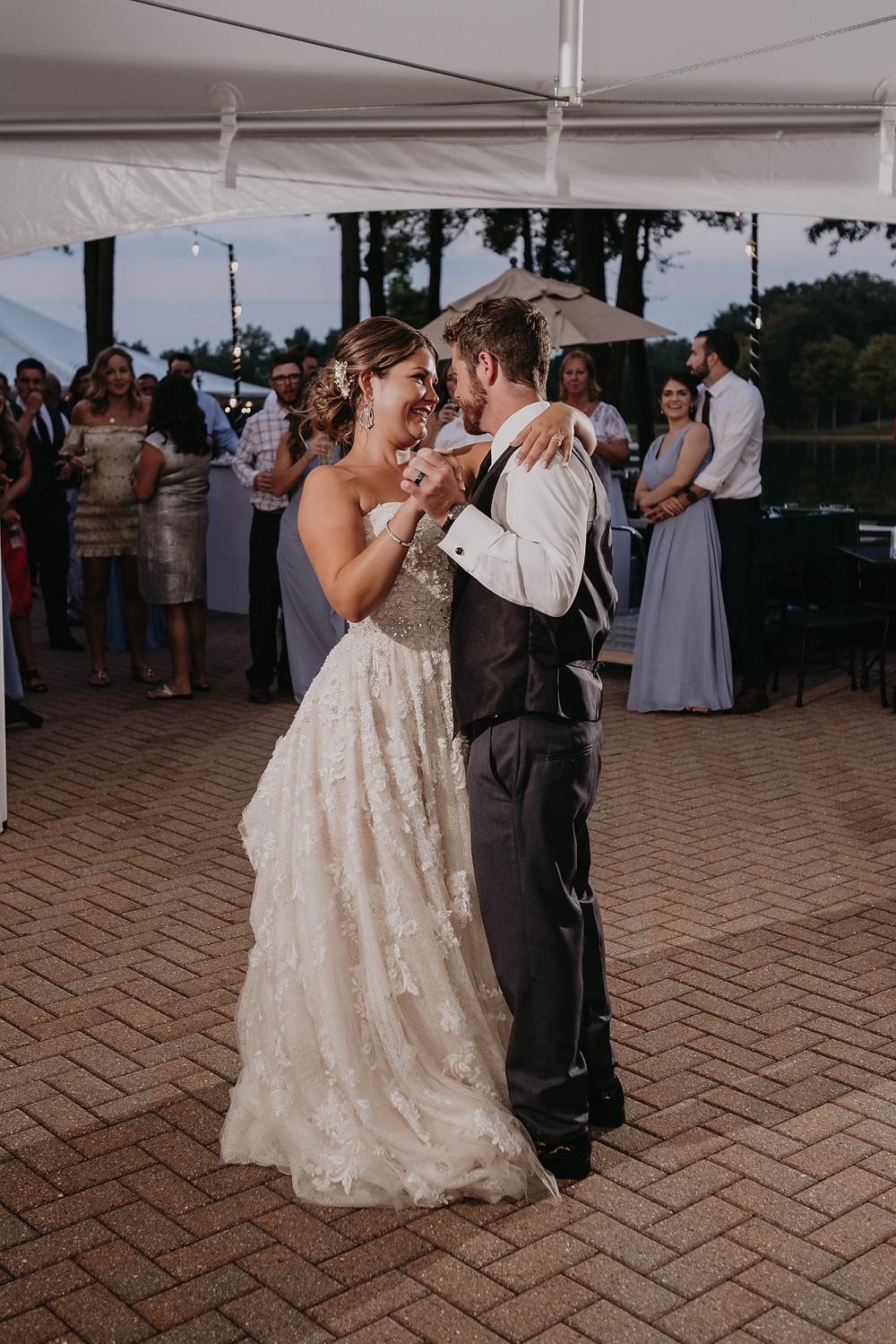 Bride and groom dancing at outdoor wedding in Metro Detroit. Photographed by Nicole Leanne Photography.