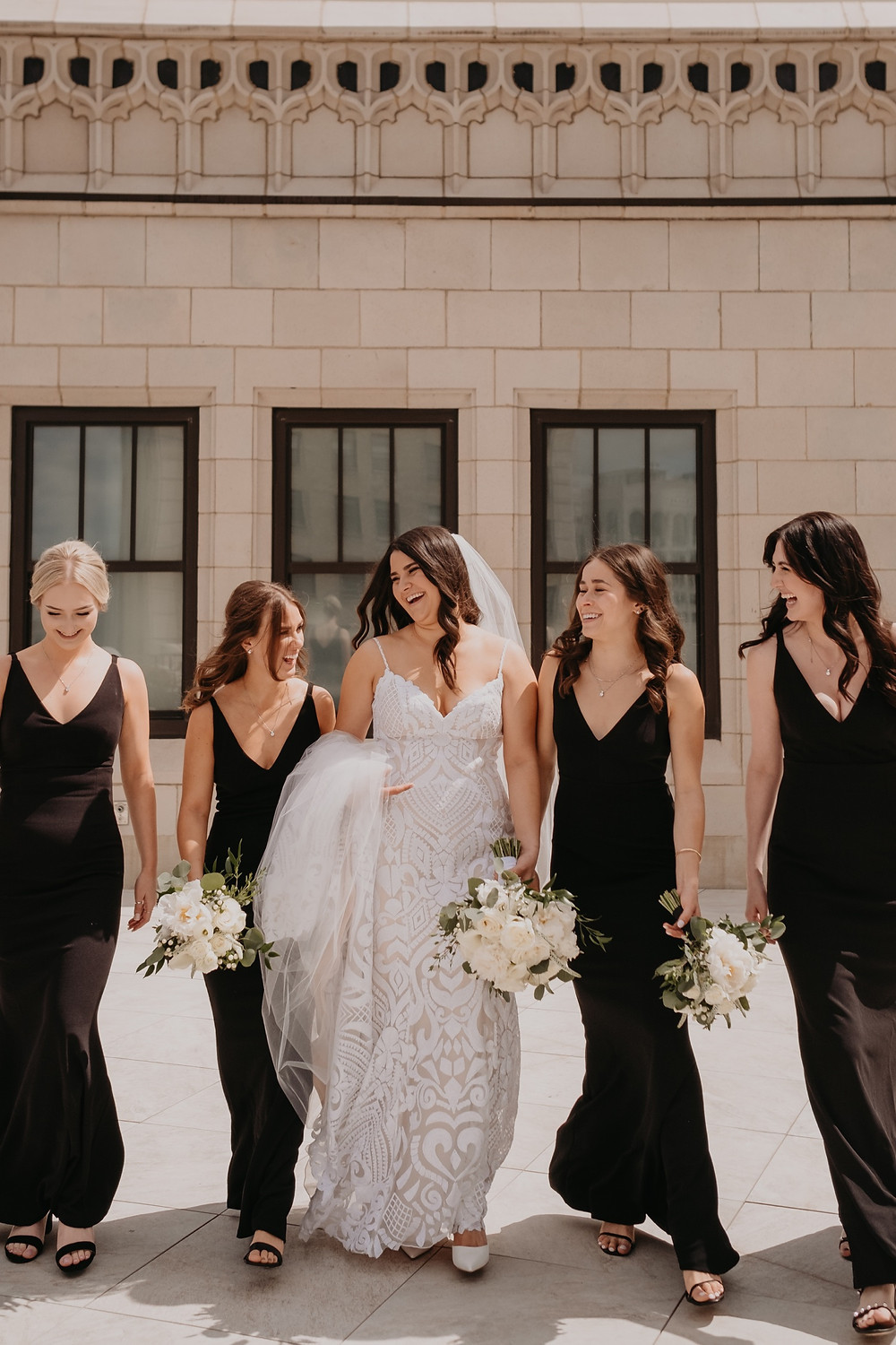 Bride with bridesmaids in Detroit wedding. Photographed by Nicole Leanne Photography.