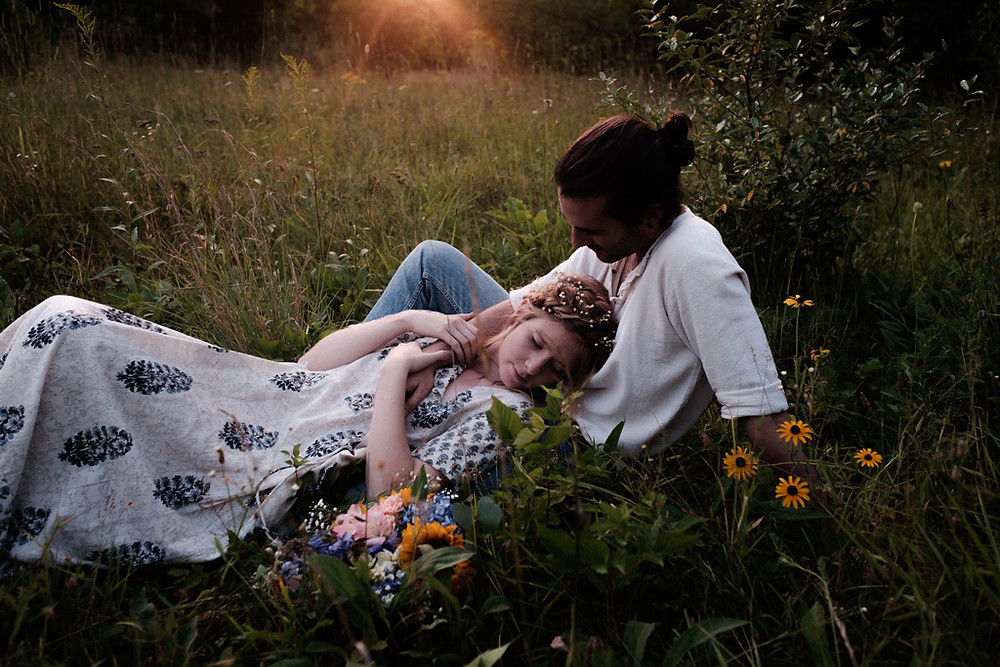 laying in the grass, wildflowers