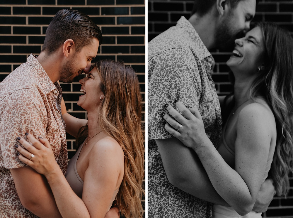 Couple laughing during engagement photos in Detroit. Photographed by Nicole Leanne Photography.