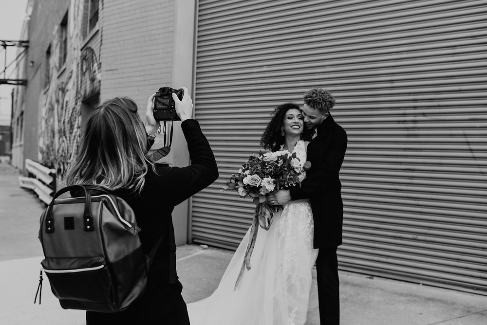 Wedding photos at Eastern Market in Detroit. Photographed by Nicole Leanne Photography
