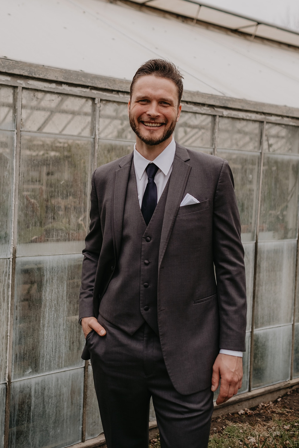 Groom at Graye's greenhouse. Photographed by Nicole Leanne Photography.