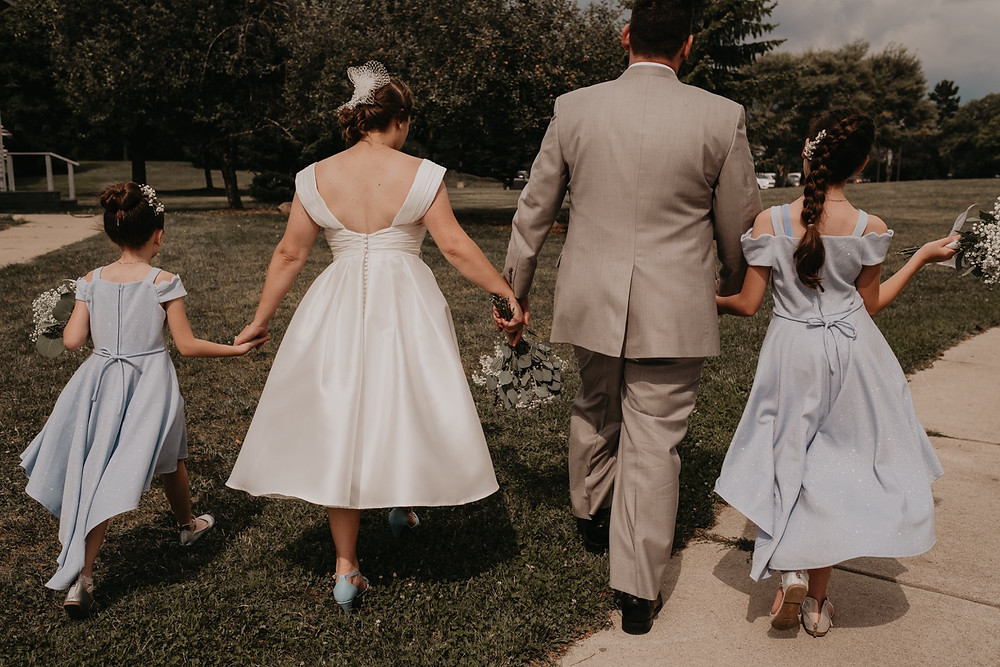 Family walking together after wedding ceremony at Meridian Historical Village. Photographed by Nicole Leanne Photography.