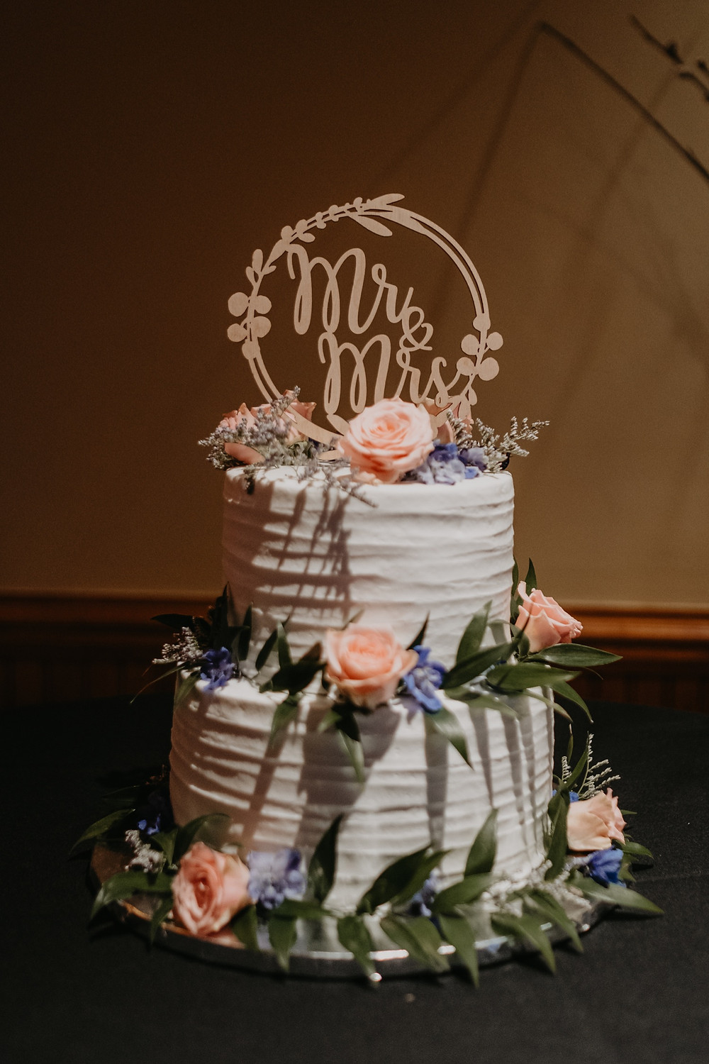 Two tier wedding cake with florals. Photographed by Nicole Leanne Photography.