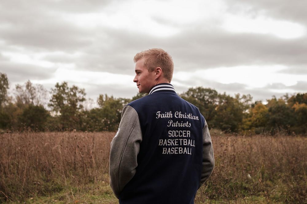 varsity jacket, high school senior portrait
