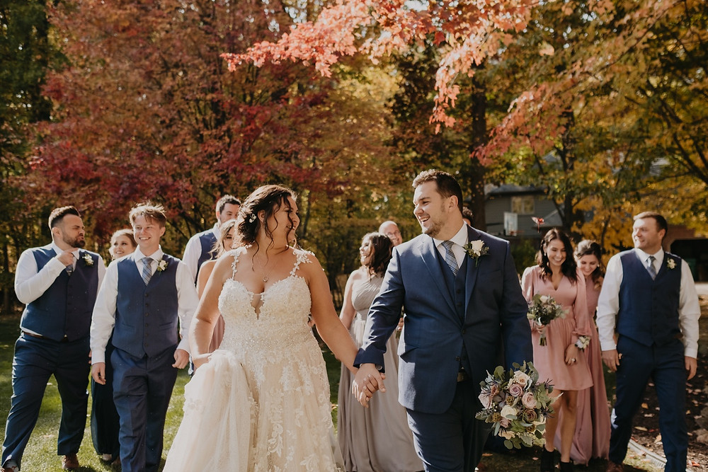 Metro Detroit couple with their bridal party on fall wedding day
