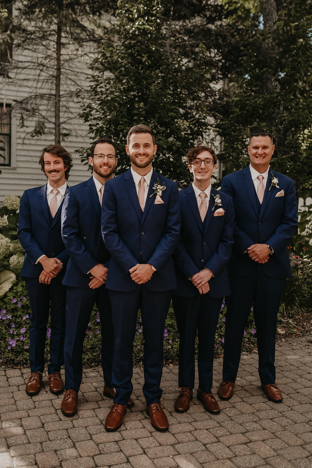 Groomsmen at Mackinac summer wedding. Photographed by Nicole Leanne Photography.