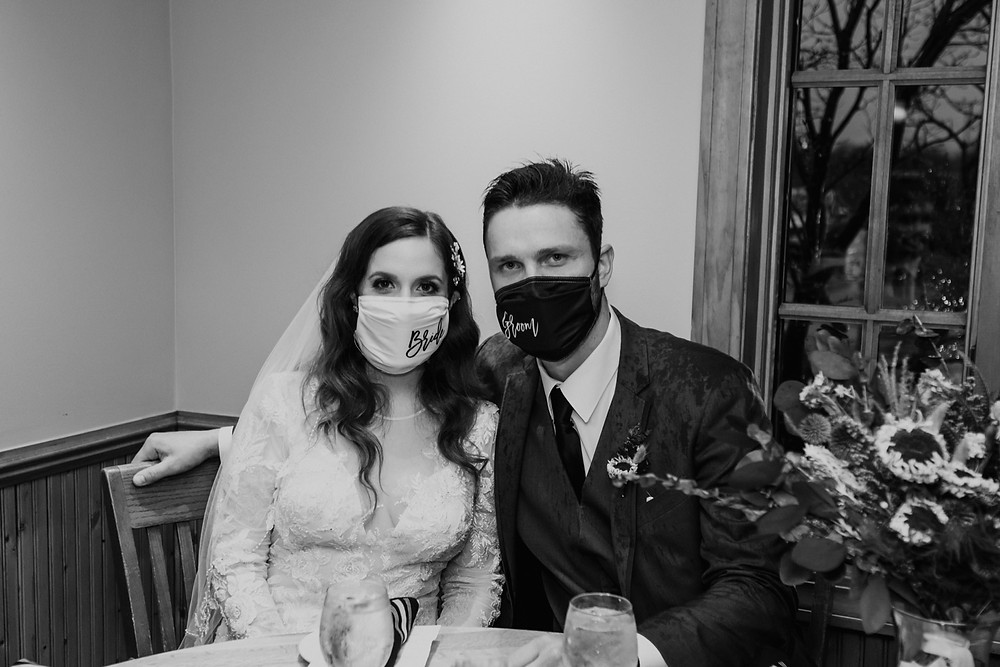 Bride and groom wearing masks during 2021 pandemic wedding. Photographed by Nicole Leanne Photography.