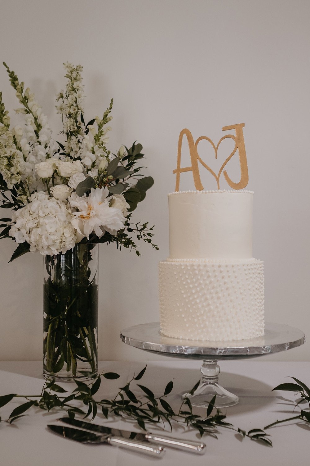 Minimalist two tier wedding cake in Detroit. Photographed by Nicole Leanne Photography.