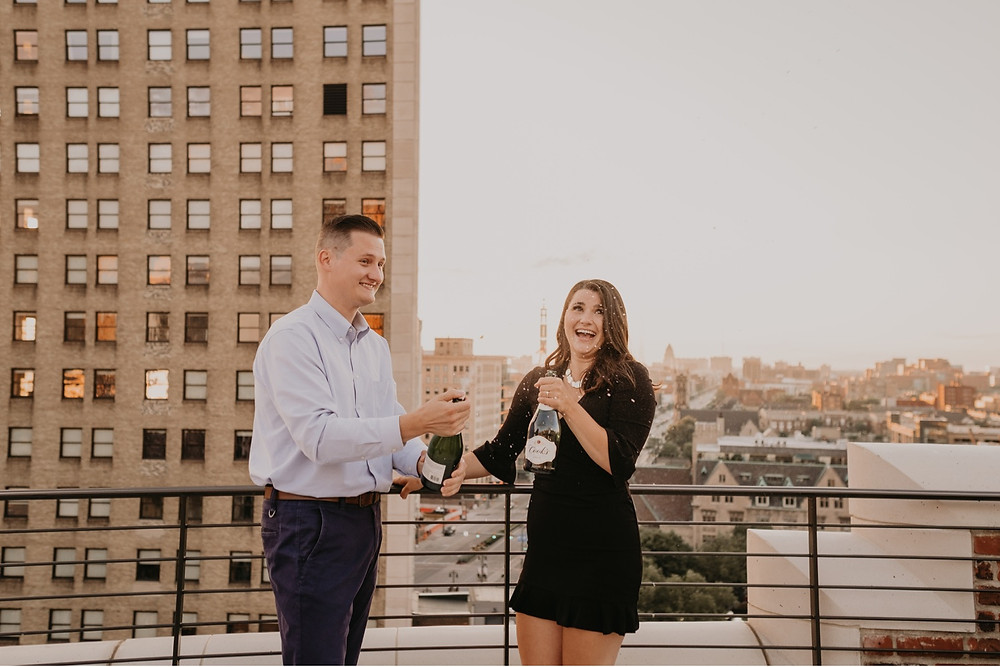 Celebratory champagne shower on Detroit rooftop. Photographed by Nicole Leanne Photography.
