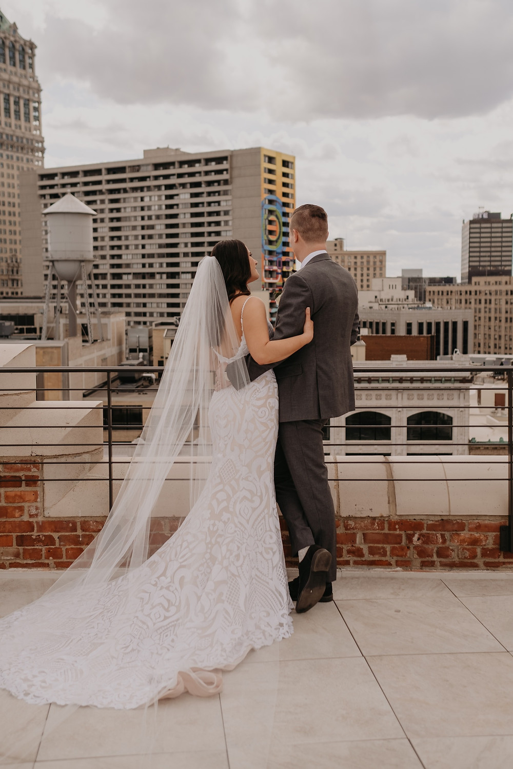 Bride and groom overlooking Downtown Detroit. Photographed by Nicole Leanne Photography.