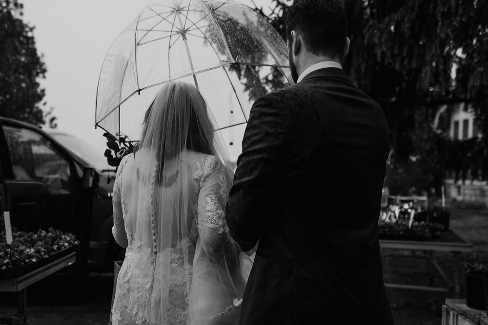 Rainy day wedding photography. Photographed by Nicole Leanne Photography.