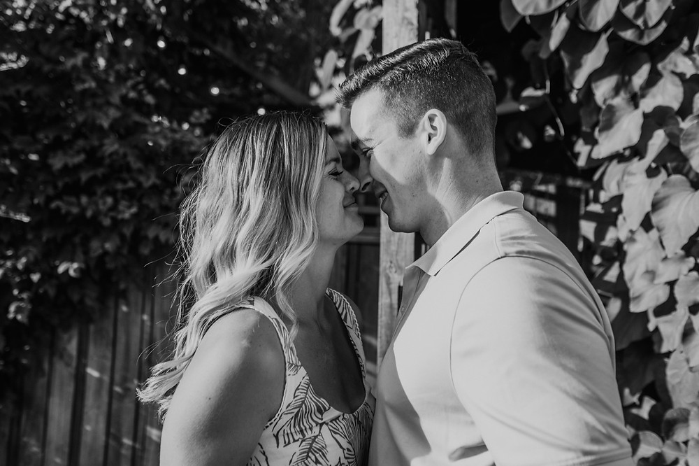 Black and white casual wedding photos in backyard. Photographed by Nicole Leanne Photography.