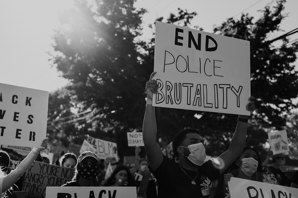 End police brutality protest signs in Berkley Michigan protest